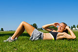 Fit woman doing sit ups