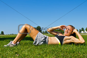 Fit woman doing sit ups