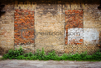Old wall with immured windows