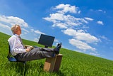 Businessman Relaxing Thinking At Desk in Green Field