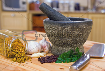 Kitchen scene showing a pestle and mortar and spices