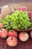 Autumnal ripe fruits and veg - green grape, red apples and pumpk