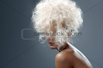 Beautiful Blonde Girl. Healthy Long Curly Hair