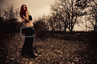 Portrait of beautiful sad girl among the autumn trees