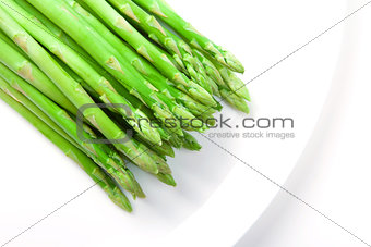 Asparagus on white plate