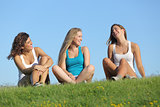 Group of three teenager girls laughing and talking outdoor