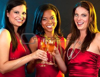 women holding champagne glasses