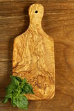 kitchen cutting board on a wooden background