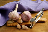 whole garlic bulbs on a cutting board
