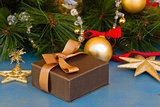 x-max gift box under fir tree