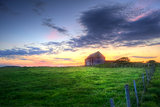 Old barn in landscape at sunset