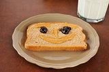 Happy face peanut butter sandwich