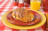 Chocolate croissant with orange juice