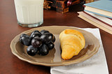 Croissant, grapes and milk