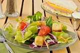 Salad with bologna and cheese sandwich