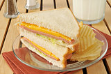 Bologna and cheese sandwich with milk