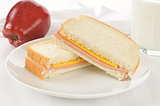 Bologna and cheese sandwich with an apple