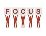 Men holding the word focus.