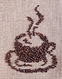 Coffee cup made of beans - on burlap background