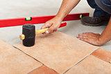 Installing ceramic flooring - fitting a tile