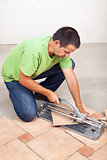 Man cutting floor tiles