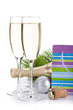 Champagne glasses and christmas gift