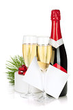 Champagne, christmas gift and empty greeting card