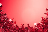 Christmas decor with stars on red background