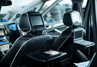 Interior of a modern car with a media system and leather seats