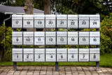 Rows of grey Mailboxes with numbers