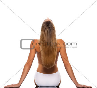 Blond haired woman stretching backwards