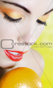 Beautiful Woman Portrait holding a mandarin