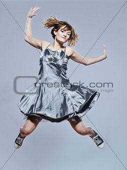 beautiful young girl with prom dress jumping happy