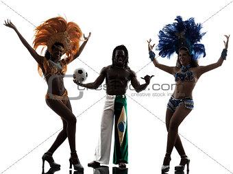 women samba dancer and soccer player man silhouette