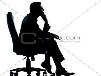 one business man sitting in armchair silhouette