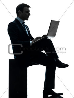 business man computing laptop computer silhouette