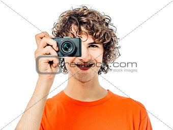 young man photographer  holding camera portrait