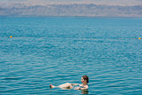 one woman swimming bathing in dead sea jordan