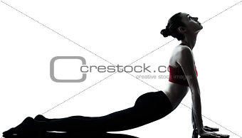 woman exercising yoga sun salutation