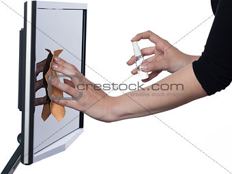 Woman wiping computer screen