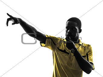one african man referee whistling pointing  silhouette