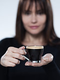 woman drinking offering coffee