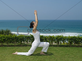 woman yoga seaside