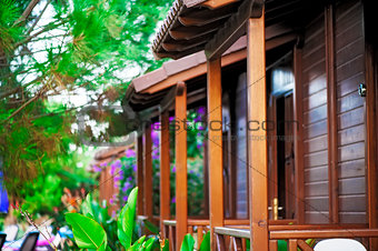 Wooden balconies bungalows in a tropical garden.