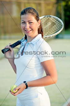 Young happy girl with a tennis racket