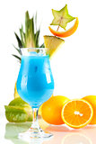 Blue Hawaii tropical cocktail with pineapple on background