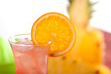 Red cocktail with orange