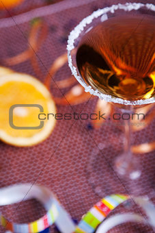 Gold cocktail in martini glass