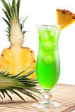 Green tropical cocktail with pineapple slice