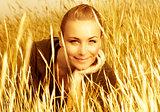 Girl's portrait in golden wheat